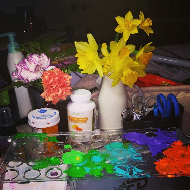 messy desk with daffs and carnations 2.17.15